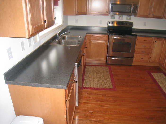 Cons of granite countertops cool polished black granite for Stainless steel countertops cost per sq ft